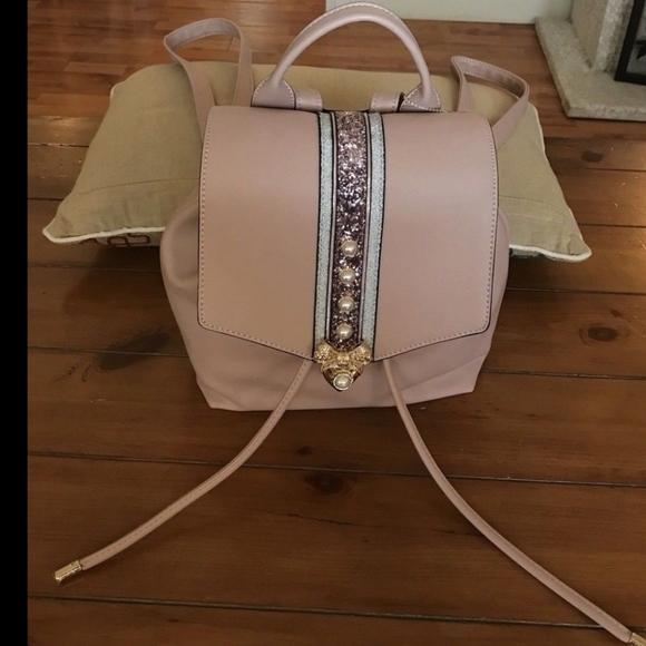 1e829cdbc323 Aldo Aradoven Pearl Pink Backpack Gold Bow  89